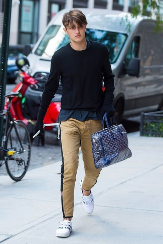 How to wear: white low top sneakers, khaki chinos, navy crew-neck t-shirt, black crew-neck sweater