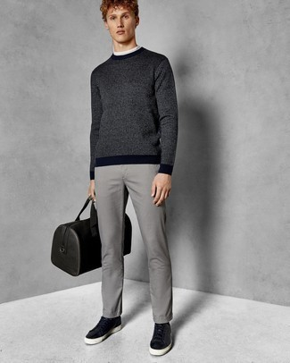 How to Wear Black Leather Low Top Sneakers For Men: A navy vertical striped crew-neck sweater and grey chinos make for the ultimate off-duty style for today's guy. Black leather low top sneakers are a savvy option to finish your ensemble.