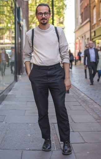 How to Wear Black Leather Derby Shoes: This combo of a beige crew-neck sweater and charcoal chinos is solid proof that a pared down casual outfit doesn't have to be boring. Slip into black leather derby shoes for an extra dose of class.