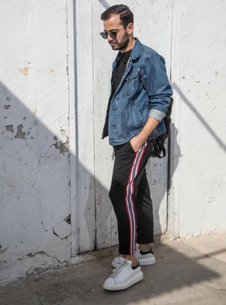 How to wear: white leather low top sneakers, black vertical striped chinos, black crew-neck t-shirt, blue denim jacket