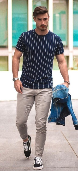How to wear: black canvas low top sneakers, beige chinos, white and navy vertical striped crew-neck t-shirt, blue denim jacket