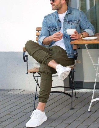 How to wear: white athletic shoes, olive chinos, white crew-neck t-shirt, blue denim jacket