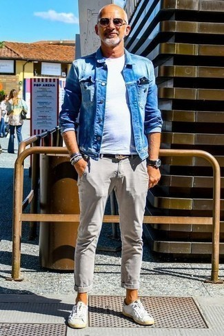 How to Wear Dark Purple Sunglasses For Men: This combo of a blue denim jacket and dark purple sunglasses is street style cool meets relaxed comfort. Let your outfit coordination skills really shine by rounding off your getup with white leather low top sneakers.