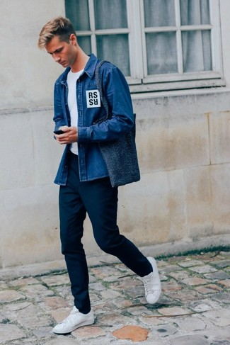 How to Wear a Blue Denim Shirt For Men: The combo of a blue denim shirt and navy chinos makes this a killer laid-back ensemble. We're totally digging how cohesive this outfit looks when finished off with white leather low top sneakers.