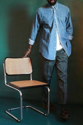 How to Wear a Light Blue Denim Shirt For Men: In fashion situations comfort is essential, this combo of a light blue denim shirt and dark green chinos is a no-brainer. Balance your look with a smarter kind of footwear, such as these dark brown leather loafers.