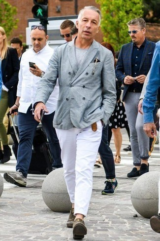 Men's Looks & Outfits: What To Wear In Summer: Rock a grey double breasted blazer with white chinos to achieve a dressy, but not too dressy ensemble. For a modern on and off-duty mix, add olive leather derby shoes to your ensemble. This here is hard proof that one actually can survive the crazy heat and look cool and fresh while doing so.