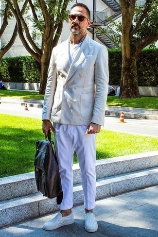 How to Wear a Beige Double Breasted Blazer For Men: Demonstrate that you do smart casual men's style like a connoisseur of men's style in a beige double breasted blazer and brown chinos. Balance this ensemble with more laid-back shoes, such as these white leather slip-on sneakers.