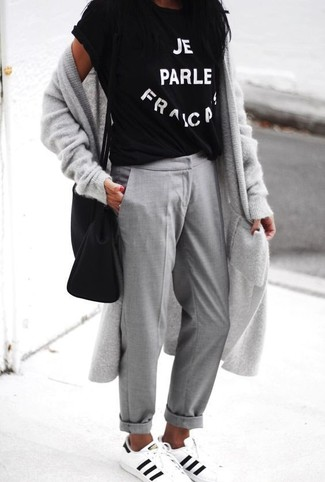 How to wear: white and black leather low top sneakers, grey chinos, black and white print crew-neck t-shirt, grey long cardigan