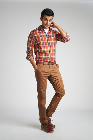 Men's Looks & Outfits: What To Wear In 2020: This casual combo of a red plaid long sleeve shirt and brown chinos is a safe bet when you need to look great but have no time to spare. Complement your look with brown leather boat shoes for extra style points.