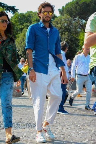 How to Wear Gold Sunglasses For Men: If the setting permits a laid-back look, rock a blue chambray long sleeve shirt with gold sunglasses. White canvas low top sneakers will infuse an air of class into an otherwise straightforward outfit.