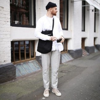 Men's Looks & Outfits: What To Wear In 2020: A white long sleeve shirt and grey chinos married together are a match made in heaven for guys who love cool and casual styles. When this outfit looks all-too-classic, dial it down by slipping into a pair of beige canvas low top sneakers.