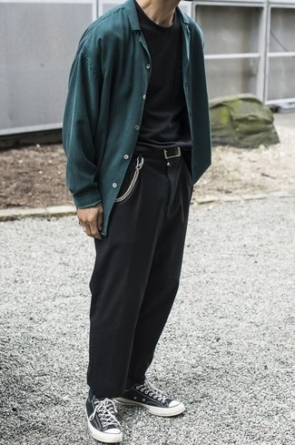 How to Wear a Teal Long Sleeve Shirt For Men: If you're searching for an off-duty yet seriously stylish look, opt for a teal long sleeve shirt and black chinos. Black and white canvas low top sneakers are guaranteed to bring a touch of stylish casualness to this getup.