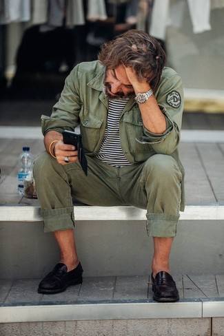 How to wear: black leather loafers, olive chinos, white and black horizontal striped crew-neck t-shirt, olive military jacket