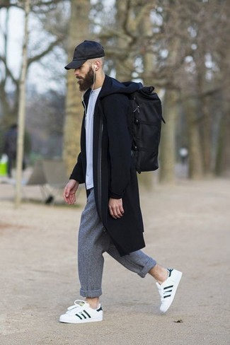 How to wear: white and black leather low top sneakers, grey wool chinos, white crew-neck t-shirt, black overcoat