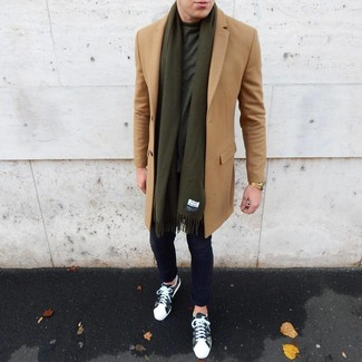 How to wear: olive camouflage low top sneakers, navy chinos, dark green crew-neck t-shirt, camel overcoat