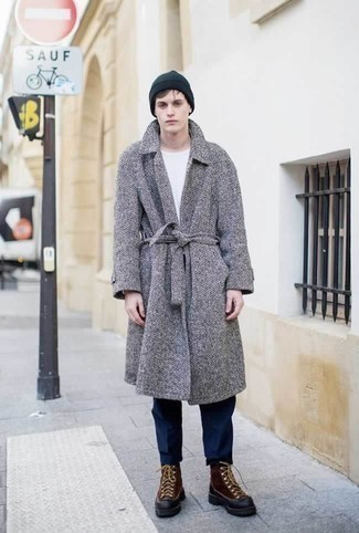 How to Wear a Grey Herringbone Overcoat: A grey herringbone overcoat and navy chinos are absolute wardrobe heroes if you're putting together a polished wardrobe that holds to the highest menswear standards. Brown leather snow boots are the simplest way to bring a sense of stylish casualness to this look.