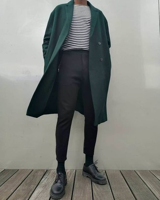 How to Wear a Dark Green Overcoat: This pairing of a dark green overcoat and black chinos is a tested option when you need to look casually smart in a flash. Inject this getup with a sense of elegance by slipping into a pair of black leather derby shoes.