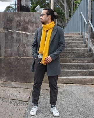 How to Wear a Grey Overcoat: For an ensemble that's casually smart and wow-worthy, go for a grey overcoat and black vertical striped chinos. Let your sartorial skills really shine by finishing off this look with a pair of white canvas low top sneakers.