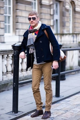 How to wear: dark brown leather chelsea boots, brown chinos, white and navy horizontal striped crew-neck t-shirt, navy pea coat