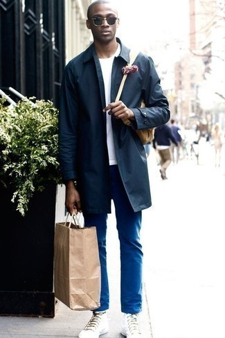How to Wear a White Crew-neck T-shirt For Men: Flaunt your credentials in men's fashion by combining a white crew-neck t-shirt and blue chinos for a casual getup. For a more laid-back vibe, why not complete this getup with a pair of white canvas high top sneakers?