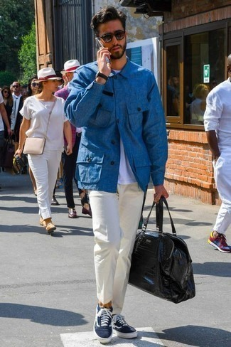 How to Wear a Black Leather Duffle Bag For Men: If you enjoy the comfort look, wear a blue shirt jacket and a black leather duffle bag. Clueless about how to complement this look? Finish with navy and white canvas low top sneakers to dial up the fashion factor.
