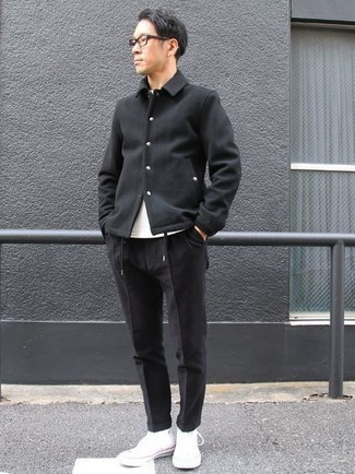 Fashion for 30 Year Old Men: What To Wear: Undeniable proof that a black shirt jacket and black chinos look amazing when teamed together. Balance out your ensemble with more laid-back shoes, like this pair of white canvas high top sneakers. Gentlemen who are curious how to dress stylishly as you get into your 30s, you have your answer.