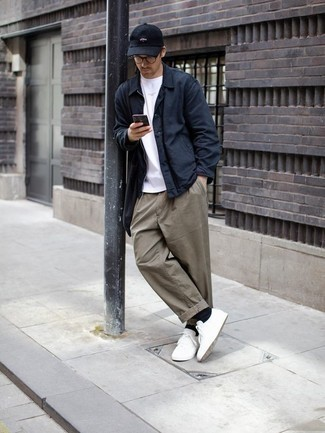 Which Low Top Sneakers To Wear With a White Crew-neck T-shirt For Men: For something more on the off-duty end, wear this combo of a white crew-neck t-shirt and grey chinos. The whole ensemble comes together if you complement your getup with a pair of low top sneakers.