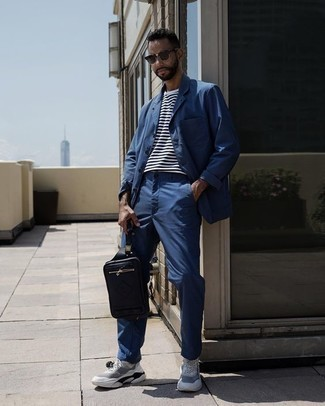 How to Wear a Black Leather Fanny Pack For Men: Wear a blue shirt jacket with a black leather fanny pack for an unexpectedly cool look. Complement this look with white and black athletic shoes and ta-da: the outfit is complete.