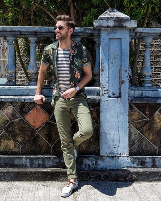 How to wear: white canvas low top sneakers, olive chinos, white and navy horizontal striped crew-neck t-shirt, dark green floral short sleeve shirt