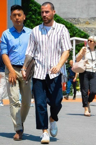 How to Wear a White Vertical Striped Short Sleeve Shirt For Men: For an off-duty look, dress in a white vertical striped short sleeve shirt and navy chinos — these two pieces work beautifully together. A pair of white leather low top sneakers will pull the whole thing together.