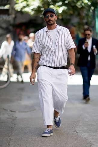 How to Wear a White Vertical Striped Short Sleeve Shirt For Men: This laid-back combination of a white vertical striped short sleeve shirt and white chinos is a fail-safe option when you need to look cool but have no time to dress up. On the shoe front, this ensemble pairs perfectly with navy canvas low top sneakers.