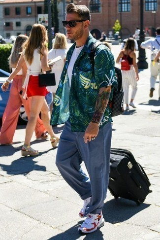 How to Wear a Black Suitcase For Men: The pairing of a dark green print short sleeve shirt and a black suitcase makes this a killer casual getup. White and red athletic shoes will infuse an air of refinement into an otherwise too-common getup.