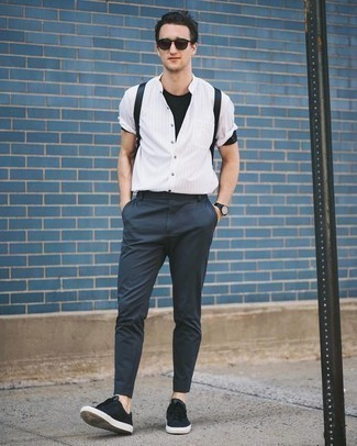 How to Wear a White Vertical Striped Short Sleeve Shirt For Men: A white vertical striped short sleeve shirt and navy chinos are great menswear essentials that will integrate brilliantly within your daily casual routine. A pair of black canvas low top sneakers is a great idea to round off this outfit.
