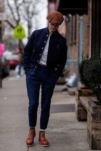 How to Wear Navy Chinos: Extremely stylish, this casual combination of a navy varsity jacket and navy chinos will provide you with variety. A pair of tobacco leather casual boots effortlessly ups the style factor of your ensemble.