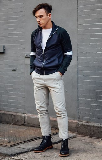 How to Wear a Navy Zip Neck Sweater For Men: This laid-back and cool look is super straightforward: a navy zip neck sweater and beige chinos. If in doubt as to what to wear in the shoe department, stick to black leather casual boots.