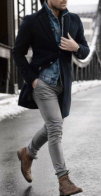 How to wear: brown leather brogue boots, grey chinos, blue denim jacket, black overcoat