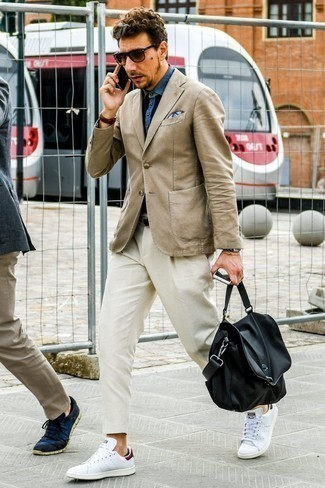 How to Wear a Blue Denim Shirt For Men: The cool-kid casual style translates here to a blue denim shirt and beige chinos. Complement your look with a pair of white leather low top sneakers and you're all done and looking boss.