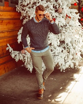 How to wear: brown leather snow boots, olive chinos, light blue denim shirt, charcoal cable sweater