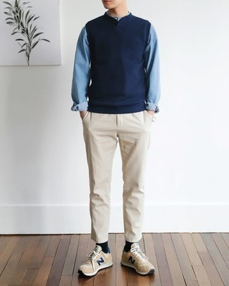 How to Wear Beige Chinos: For an ensemble that's truly wow-worthy, pair a navy sweater vest with beige chinos. Feeling bold today? Dress down your ensemble by rounding off with tan low top sneakers.