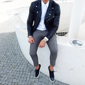 How to Wear Black Suede Low Top Sneakers For Men: This ensemble with a black leather biker jacket and grey wool chinos isn't hard to pull off and leaves room to more experimentation. When in doubt as to what to wear when it comes to footwear, add a pair of black suede low top sneakers to the equation.
