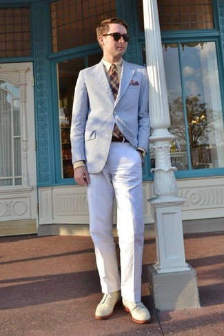 How to Wear a Brown Plaid Tie For Men: Solid proof that a white and blue vertical striped blazer and a brown plaid tie look awesome when paired together in a classy look for today's gentleman. This outfit is finished off perfectly with beige suede derby shoes.