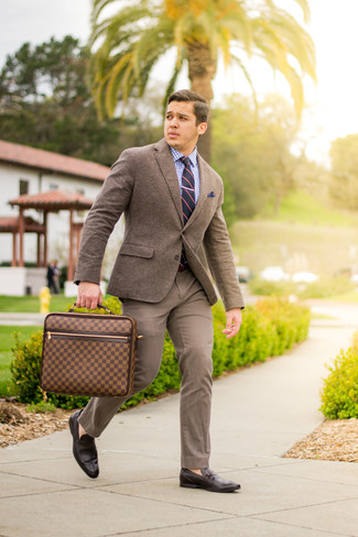 How to Wear a White and Blue Gingham Dress Shirt For Men: A white and blue gingham dress shirt and brown chinos are among the basic elements of a properly edited wardrobe. A pair of dark brown leather loafers easily elevates any outfit.