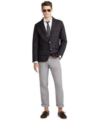 How to Wear a Black Quilted Blazer For Men: For an effortlessly stylish menswear style, choose a black quilted blazer and grey chinos — these two pieces fit brilliantly together. Throw dark brown suede boat shoes into the mix to add a sense of stylish effortlessness to this ensemble.