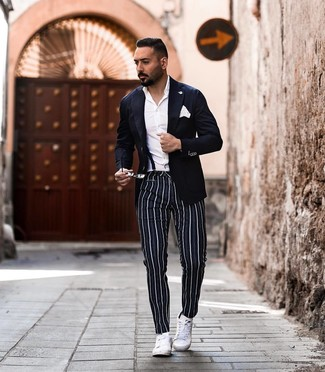 How to wear: white leather low top sneakers, navy vertical striped chinos, white dress shirt, navy blazer