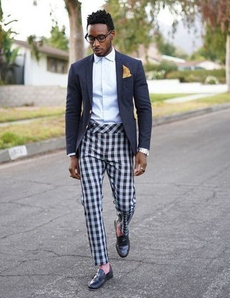 How to Wear Navy Leather Loafers For Men: Such pieces as a navy blazer and light blue check chinos are the ideal way to introduce some sophistication into your day-to-day casual repertoire. Here's how to bring an added touch of style to this ensemble: navy leather loafers.