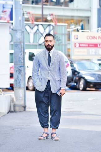 Men's Looks & Outfits: What To Wear In 2020: Parade your refined self in a white and navy vertical striped blazer and navy chinos. Finishing with a pair of blue leather sandals is the most effective way to inject a mellow touch into this ensemble.