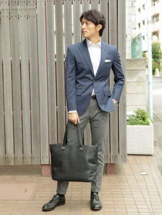 Men's Looks & Outfits: What To Wear In 2020: Putting together a navy blazer with grey chinos is an on-point choice for a casually elegant ensemble. Add a more polished twist to an otherwise standard getup by slipping into charcoal leather derby shoes.