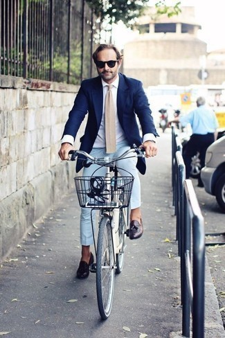 How to Wear a Beige Tie For Men: You'll be surprised at how easy it is to get dressed this way. Just a navy blazer and a beige tie. Dark purple leather tassel loafers are a great choice to complement your getup.