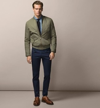 How to wear: brown leather double monks, navy chinos, light blue chambray dress shirt, olive bomber jacket