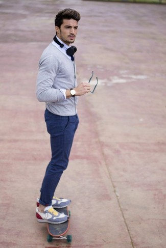 How to wear: multi colored athletic shoes, blue chinos, white dress shirt, grey cardigan